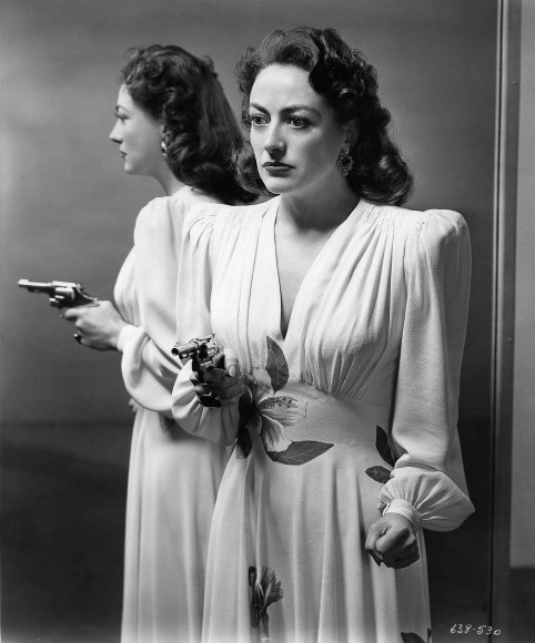 Joan Crawford in a production still for 'Mildred Pierce', costume designed by Adrian.